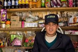 Uyghur boy running a shop