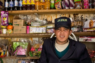 Uyghur boy running a shop