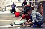 Chinese kids doing thelaundry