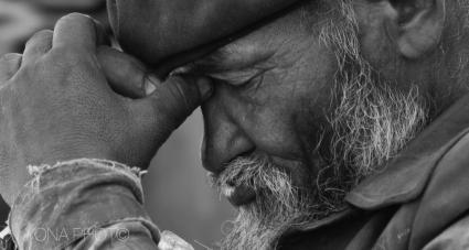 Uyghur man in thoughts, Old Town, Kashgar, Xinjiang 2011
