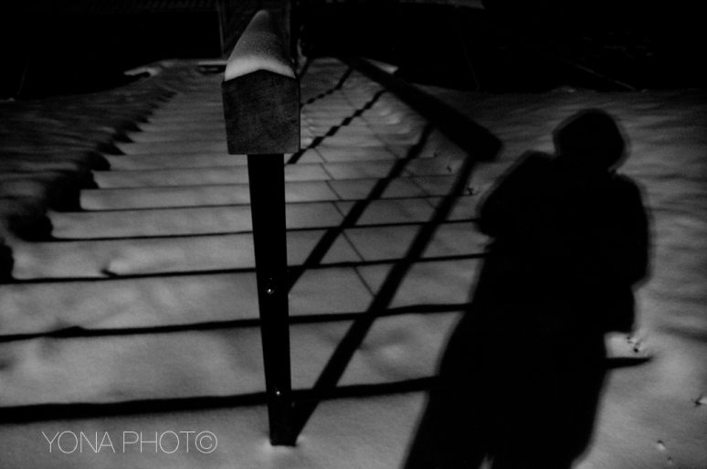 Shadows in the snow show staircases down below