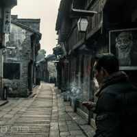 Smoking man in the streets of WuZhen