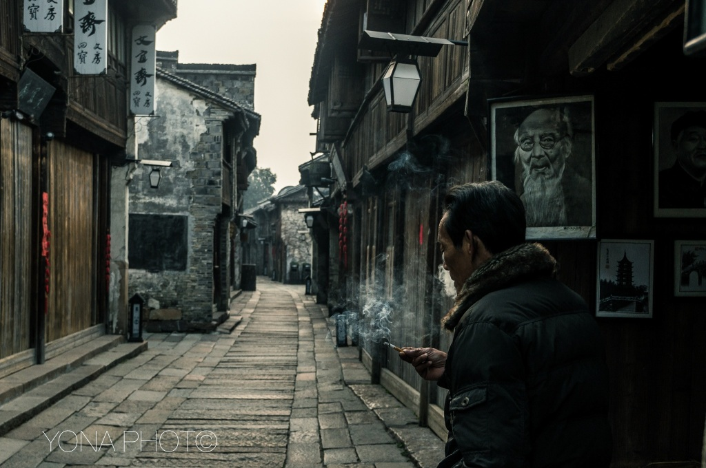 Smoking man in the streeds of WuZhen