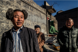 Pingyao locals selling walnuts in the street