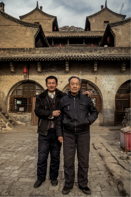 Brothers in front of their family house (for over three centuries)