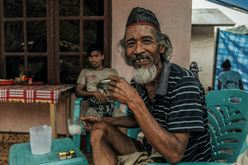 Indonesian man, enjoying a glass of Arak