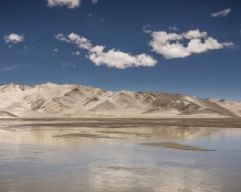 Mountain lakes emerge in the early summer when the sandy mountain tops loos their water supply due to melting