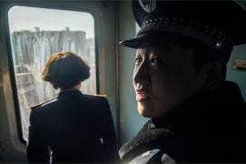 Train conductor awaiting the arrival at Pingyao - Shanxi province