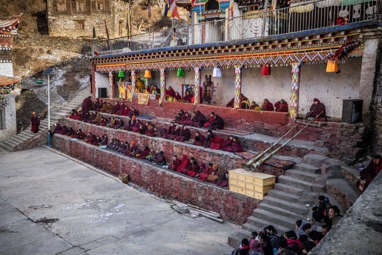 Monks await the entrance of the Dancers during Dharma Bliss Assembly festival